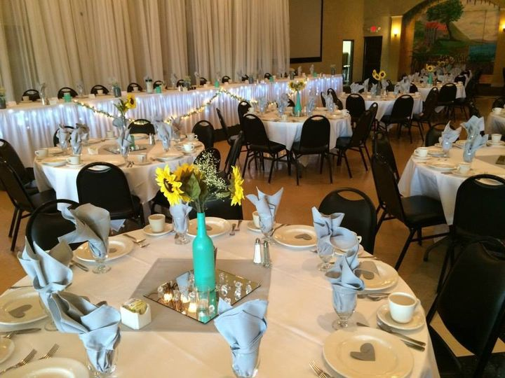 Simple table setup with sunflower centerpiece