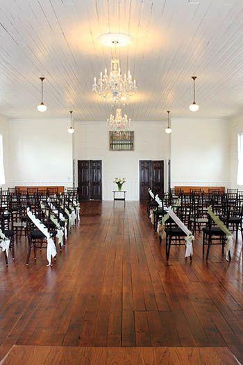 Interior of ballroom set up for wedding.