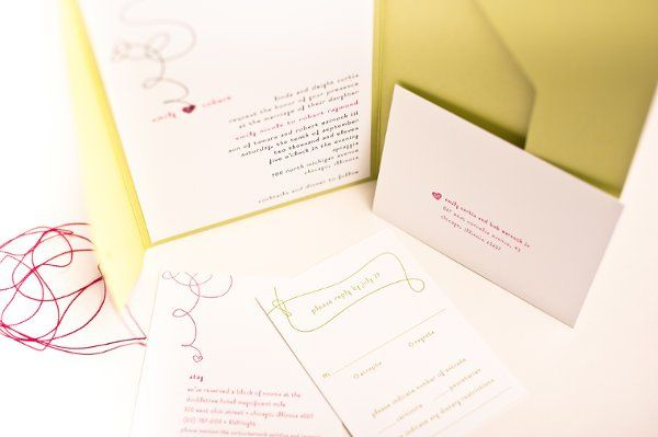 This is a Spark Letterpress invitation featuring a heart hanging off a spiraled design.  The color...