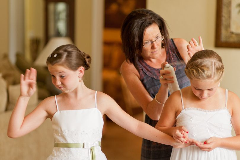 Fun photo taken at a Naples wedding of girls getting ready for wedding