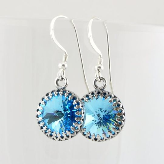 Aquamarine Swarovski Crystal Drop Earrings with Sterling Silver Accents  The authentic Swarovski...