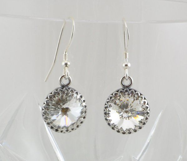 Clear Swarovski Crystal Drop Earrings with Sterling Silver Accents  The authentic Swarovski rivoli...