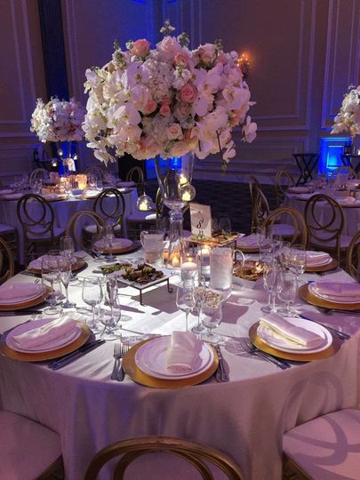 Round table setup with flower centerpiece