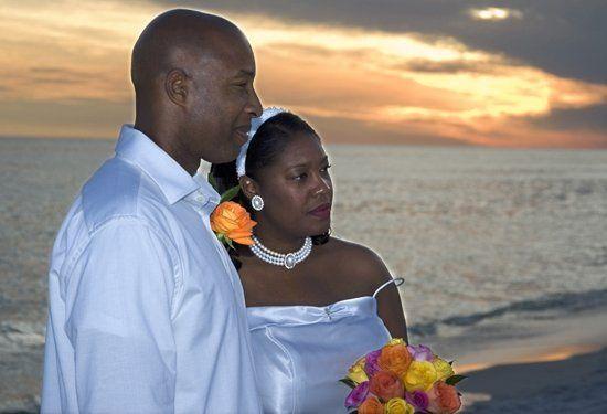 Beach wedding at sunset.