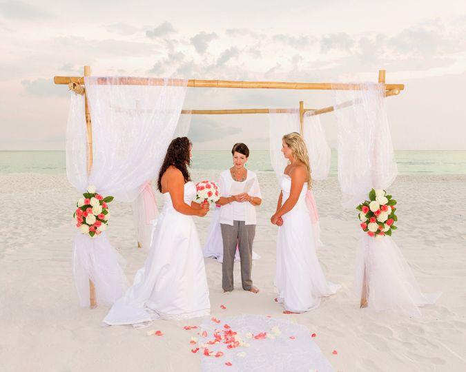 Two beautiful brides in a beach wedding in Destin, Florida.