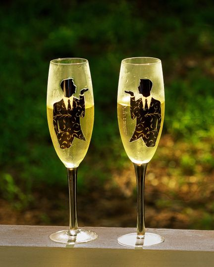 Champagne flutes for two grooms.
