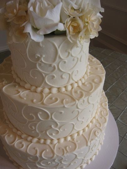 Three tier white cake with embellishments