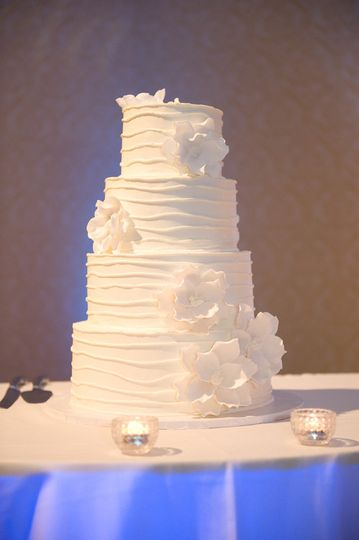 Simple four tier wedding cake with white flowers