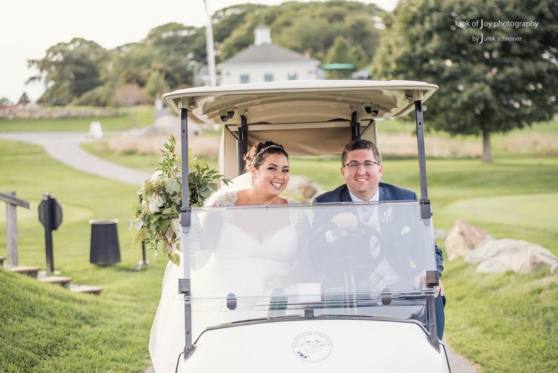 Newlyweds on a golf cart | Credit Look of Joy Photography