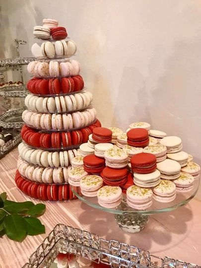From a wedding dessert table, a 10-tier Macaron Tower with custom color and flavors (red velvet,...