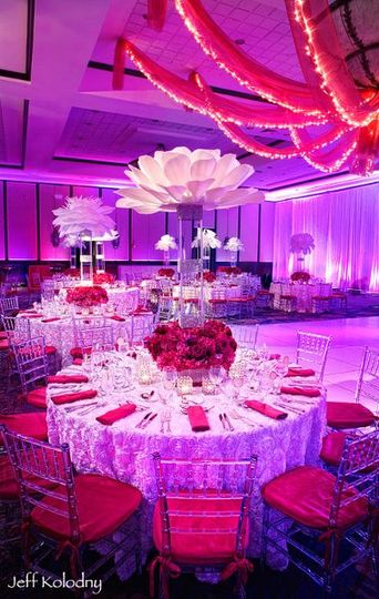 White Secret Garden overlay, Clear Chiavari chairs with a pop of Raspberry Bengaline.
