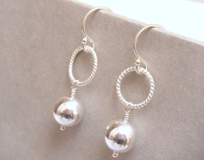 The Newbury Silver Bridal Earrings are simple, yet elegant. Pure, seamless sterling silver balls...