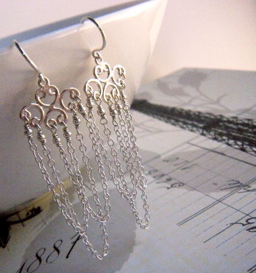 Layers of delicate, genuine sterling silver chain dangle from ornate sterling silver scroll work ear...