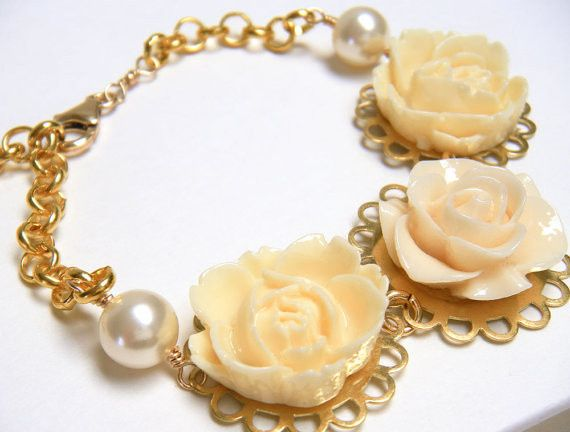 Make your wedding day special with this unique floral bracelet to give you that delicate, feminine...