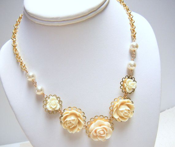 https://www.etsy.com/listing/151638158/ivory-flower-necklace-gold-flower
