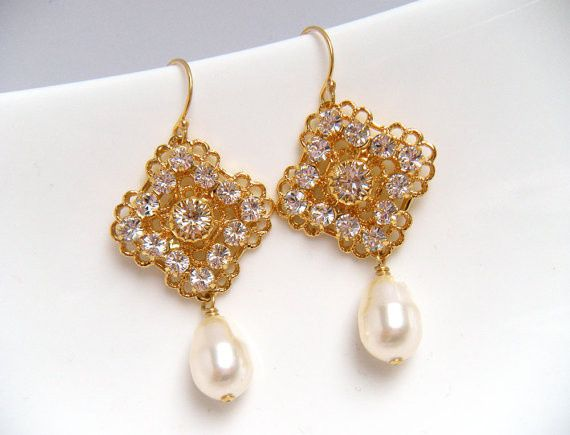 Heaven Earrings in Gold.  Swarovski teardrop pearls dangle from gold plated Swarovski rhinestone...