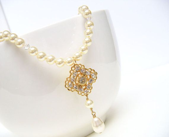 Heaven Necklace in Gold  Lovely and ornate gold plated Swarovski rhinestone focal dangles from your...