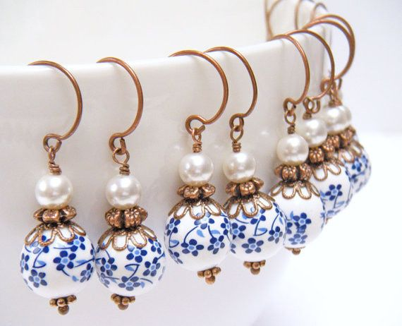 Sweet and lovely, the Dutch Blue Flower Earrings are made with antique copper components, lovely...