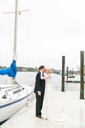 Couple kissing at the docks