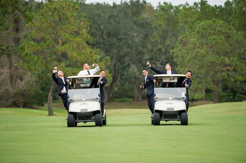 Groomsmen on golf carts