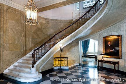The marble foyer, with its sweeping staircase, makes for a grand entrance and a picturesque location...