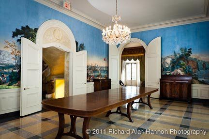 The state dining room is an ideal space for food and drinks, with its massive antique table,...