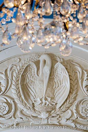 A detailed view of the crystal chandelier in the state dining room.