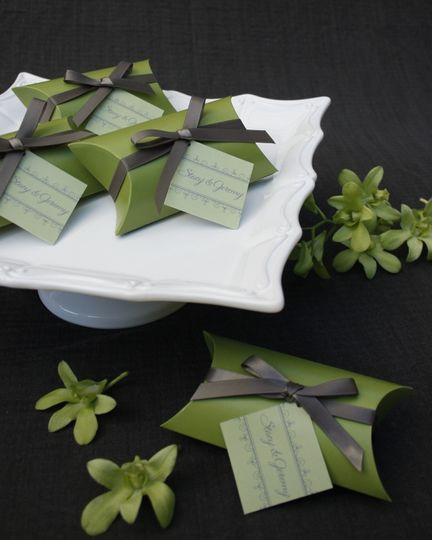 Wedding souvenirs wrapped in a green colored paper