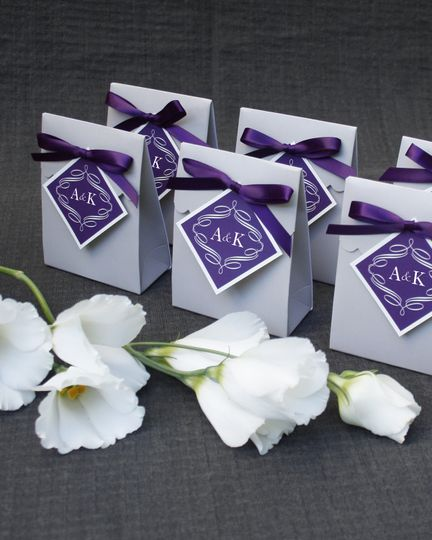 Wedding souvenirs with purple ribbon