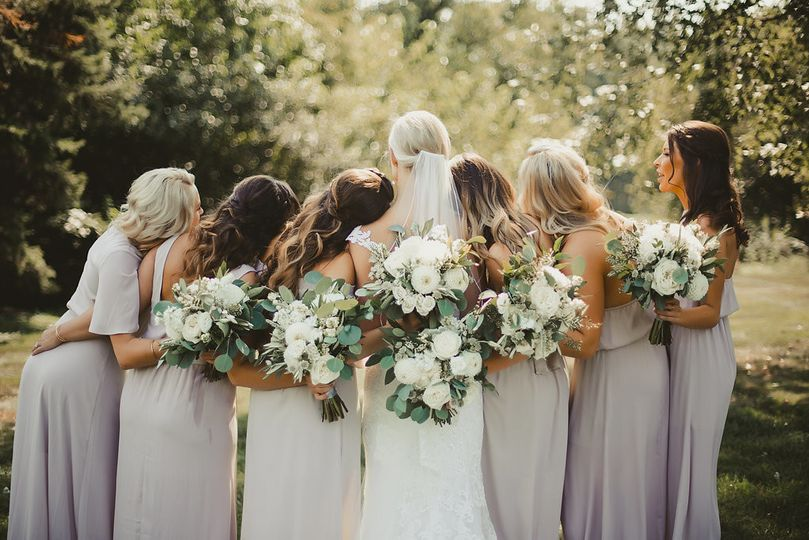 Bride and her bridesmaids with their bouquets