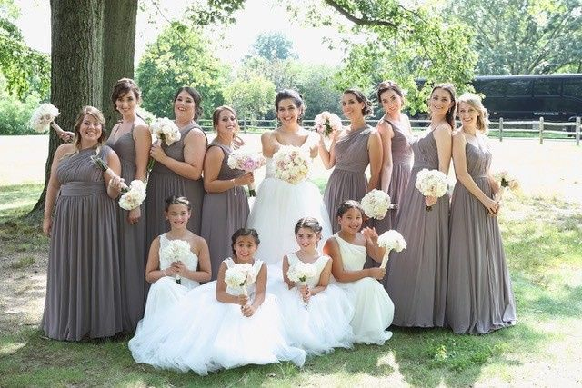 The bride, bridesmaids and flower girls