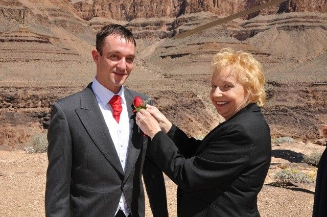 Wearing his boutonniere