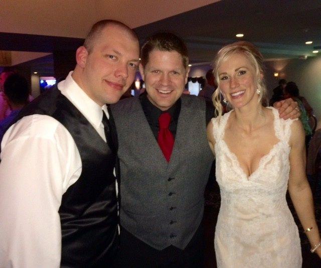 Couple with wedding DJ
