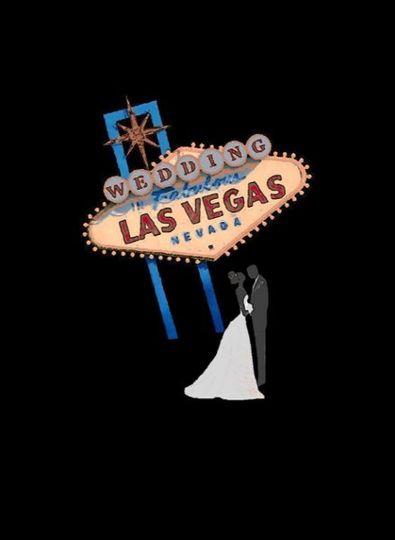 Bride & Groom standing near Las Vegas Sign