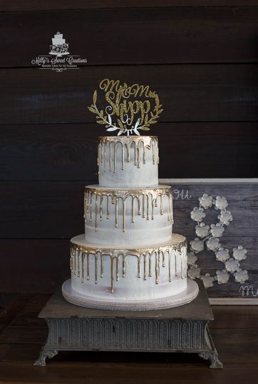 rustic barely naked wedding cake with gold dripping 002 51 529340
