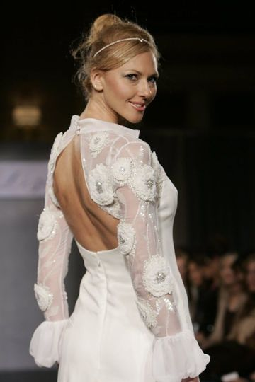 Fit and flare wedding dress with a beaded top in delicate sequins and rhinestones. Made in Silk