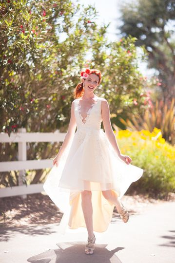 Fun high-low wedding dress with a very low neckline. French lace detail over silk organza.