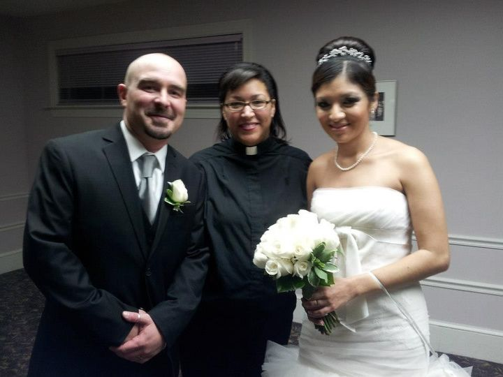 The couple and the wedding officiant