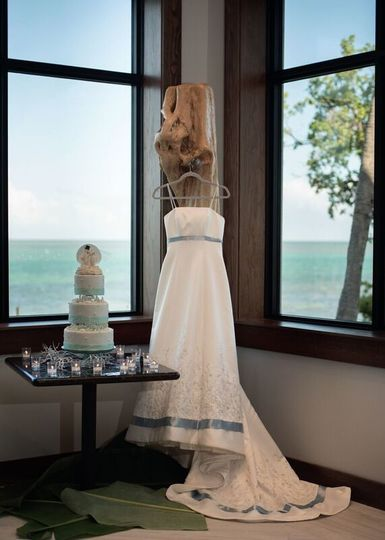 Wedding dress by the wedding cake