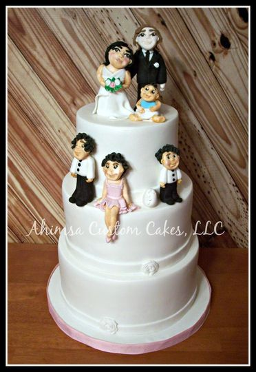 """Hand sculpted sugar figures & """"cracked egg"""" to represent a child on the way"""