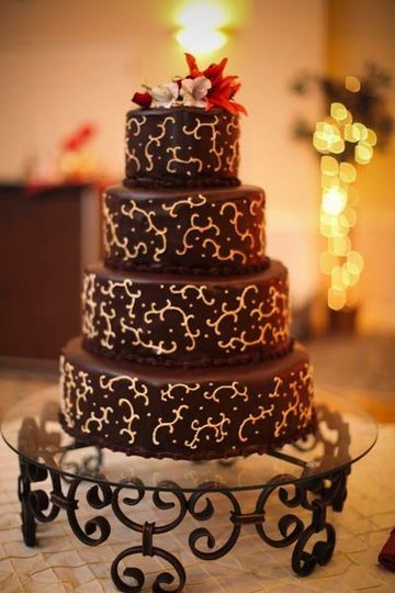 Chocolate ganache made with fine imported chocolate, accented with gold swirls, to accent the custom...