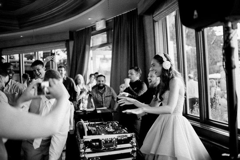 The bride on the DJ booth