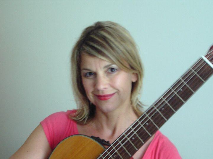 patty portrait with guitar