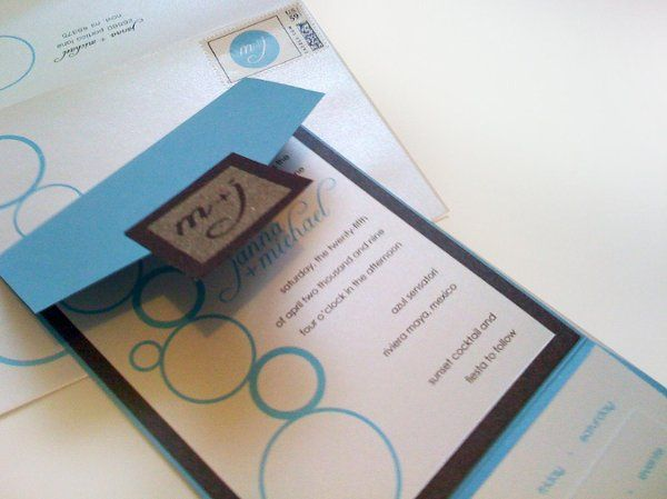 beachy keen invite with a monogram seal made from real sand!