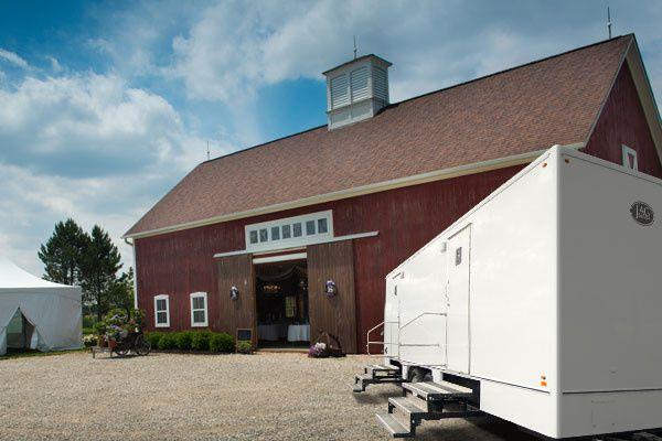 Restroom trailer by barn venue