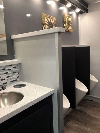 Restroom trailer urinals
