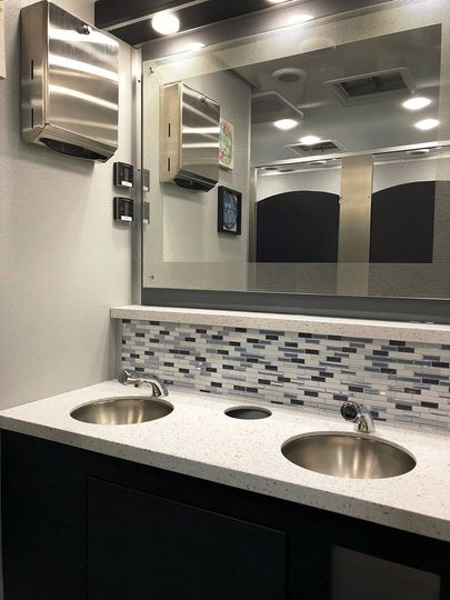 Restroom trailer sinks and mirrors