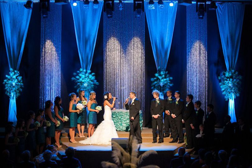 Ostrich and peacock feathers themed ceremony reception combo Wedding at Oasis Church, Lenox village,...
