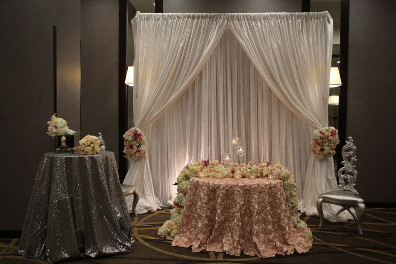 White, silver and blush sweetheart table setup, with silver throne chairs and fresh blush and pink...