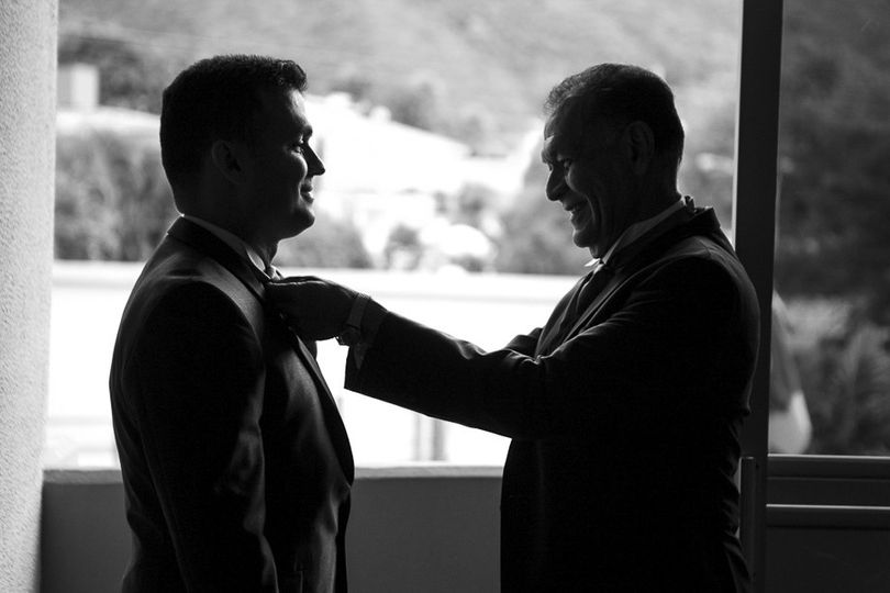 Groom and father finishing the last details